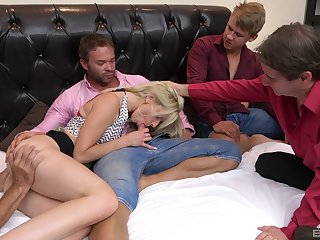 Skinny blonde sucks a bunch be worthwhile for dicks in a flawless home orgy