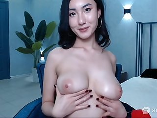 Cam Girl Rubbing Her Breast
