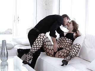Sultry Ella Celeb is wrapped in black fishnet during exceptional couch sex