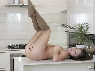 Gorgeous solo model Lili pleasures her pussy in the kitchen