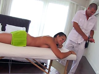 Nude amateur chick bends over for the masseur to roger her