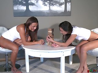 Fisting bet over a Jenga game for two sun-kissed beauties