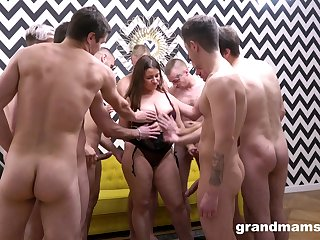Undecorated mature enjoys several dicks yon a serious gangbang tryout