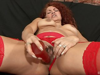 Mature redhead in stockings gets a huge cumshot from a black dude