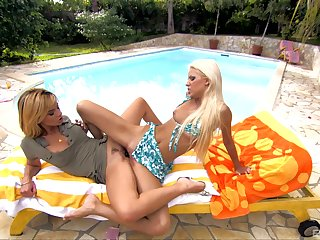 Exotic MILF lesbians Boroka Bolls and Chloe Delaure tease by the pool