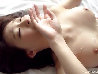 Busty Japanese babe gets her big natural tits covered with cum