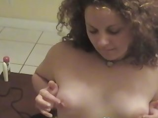 Curly haired mature solo model Lilly A masturbates with toys