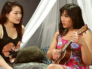 Mia Li and Lea Hart finger each others pussies