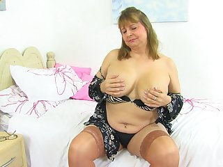 Busty buxom amateur mature blonde MILF strips and masturbates