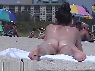 Amazing nudist girls on a hidden beach voyeur vid