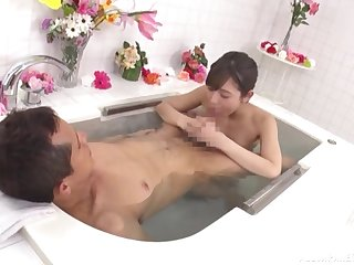 Hot Asian gives head and enjoys sperm on face relating to the tub
