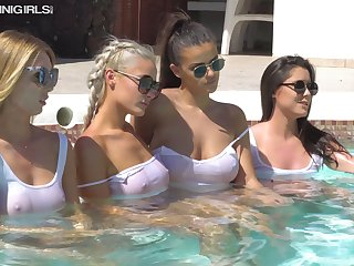 Four smoking hot chicks are sunbathing in wet white T-shirts