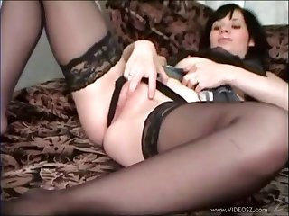 Cute bush-leaguer in  nylon stockings ID her pussy while strapping a blowjob