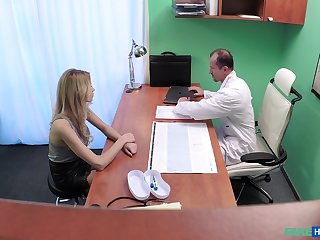 Naughty doctor fucks his sexy beauteous patient from behind. Spy cam