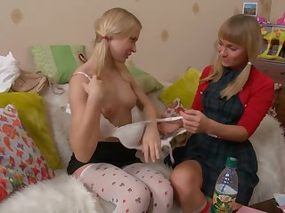 Lesbian sex with a strapon makes sexy babes Evelyn increased by Sandra G. cum